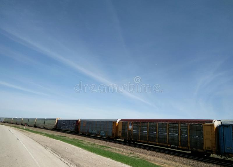 Cargo train on land. Cargo train in the sky, railway wagons in the train royalty free stock photo