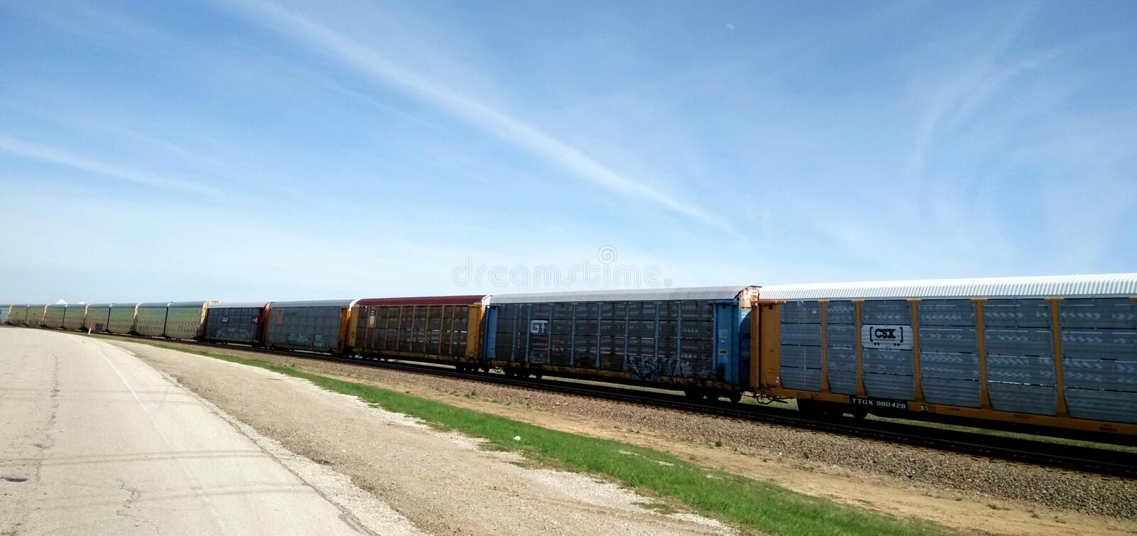 Cargo train on land. Cargo train in the sky, railway wagons in the train royalty free stock images