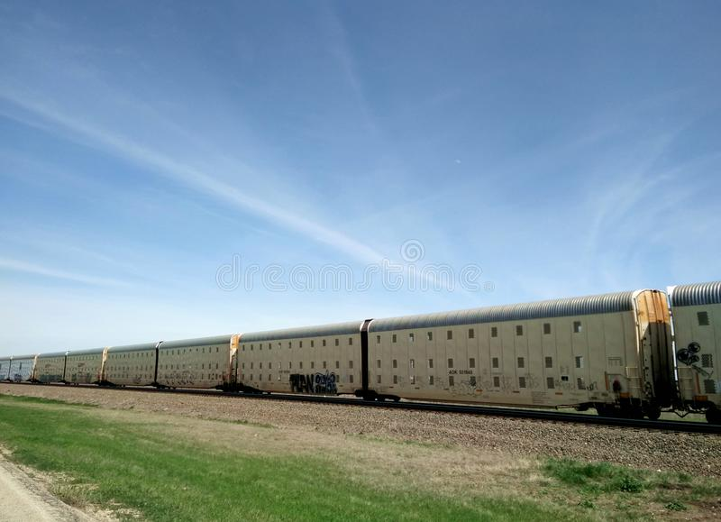 Cargo train on land. Cargo train in the sky, railway wagons in the train stock photo