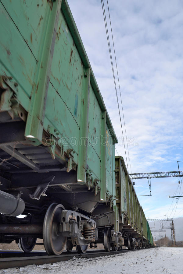Cargo train with tank cars on the tracks royalty free stock photo