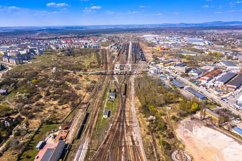 Cargo trains. Aerial view of colorful freight trains on the railway station. Wagons with goods on railroad.Aerial view.  royalty free stock image