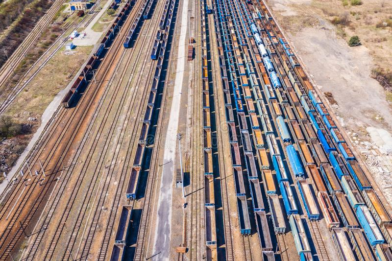 Cargo trains. Aerial view of colorful freight trains on the railway station. Wagons with goods on railroad.Aerial view.  stock image