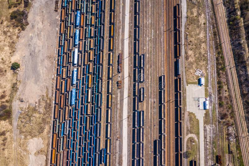 Cargo trains. Aerial view of colorful freight trains on the railway station. Wagons with goods on railroad.Aerial view.  stock photography