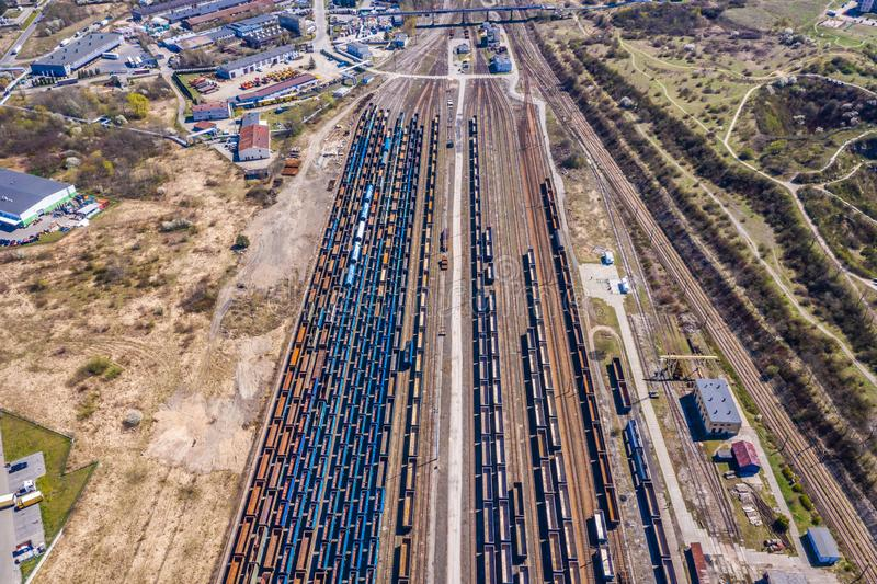 Cargo trains. Aerial view of colorful freight trains on the railway station. Wagons with goods on railroad.Aerial view.  royalty free stock images