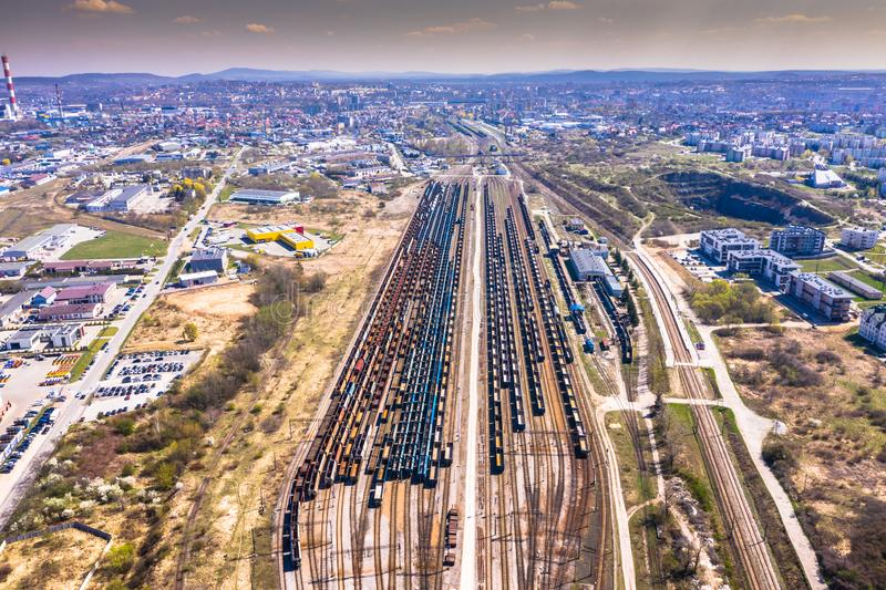 Cargo trains. Aerial view of colorful freight trains on the railway station. Wagons with goods on railroad.Aerial view.  stock photo