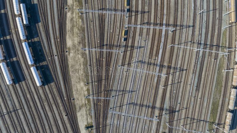 Cargo trains close-up. Aerial view of colorful freight trains on the railway station. Wagons with goods on railroad. Heavy stock image