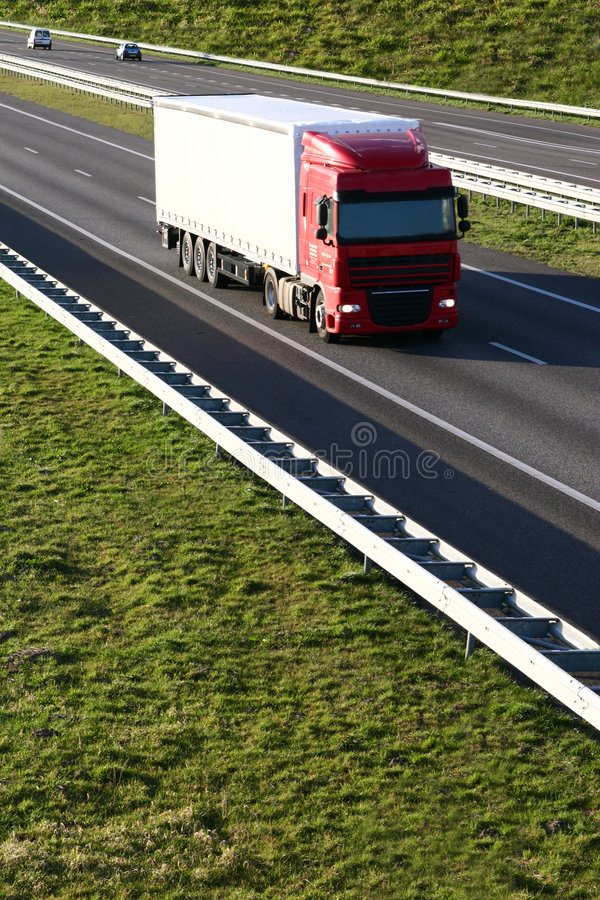 Free Cargo Truck On The Highway Stock Images - 4481564