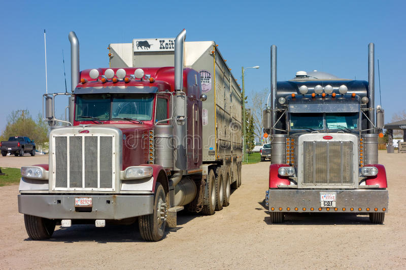 Cargo trucks parked at a rest area in canada. A closeup of typical delivery vehicles as seen in british columbia stock image