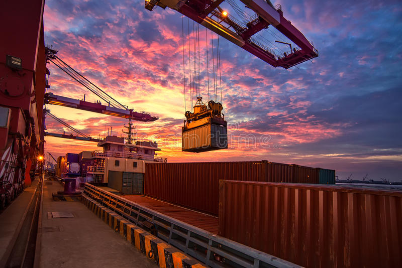 Cargo vessel lifting container royalty free stock photo