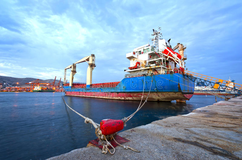 Cargo vessel. View of an old cargo vessel at a commercial port royalty free stock image