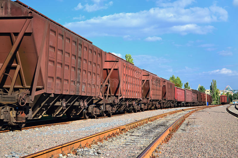 Cargo wagons. A chain of cargo wagons on a rail road royalty free stock image