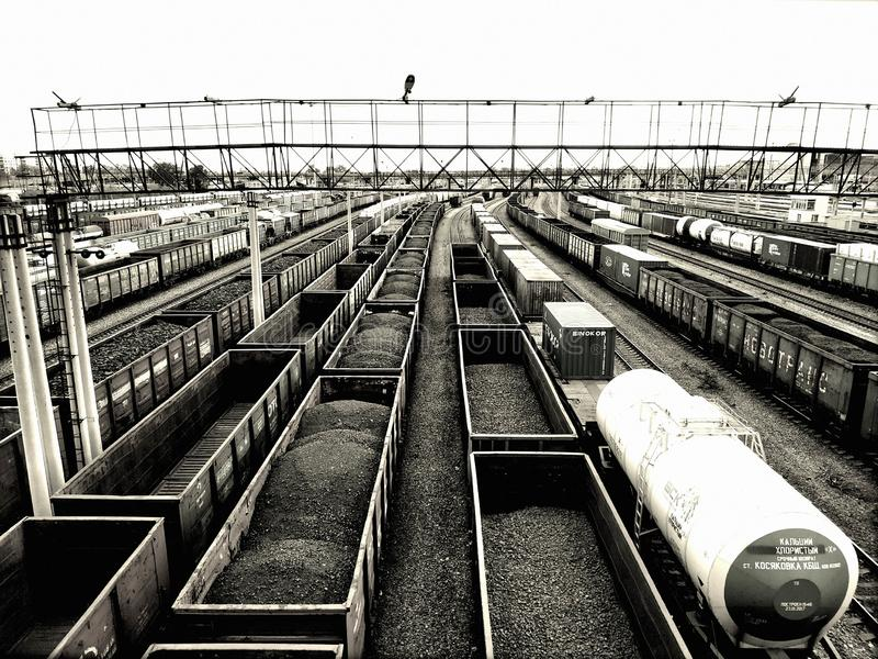 Cargo wagons with coal. On train station in city, aerial view stock image