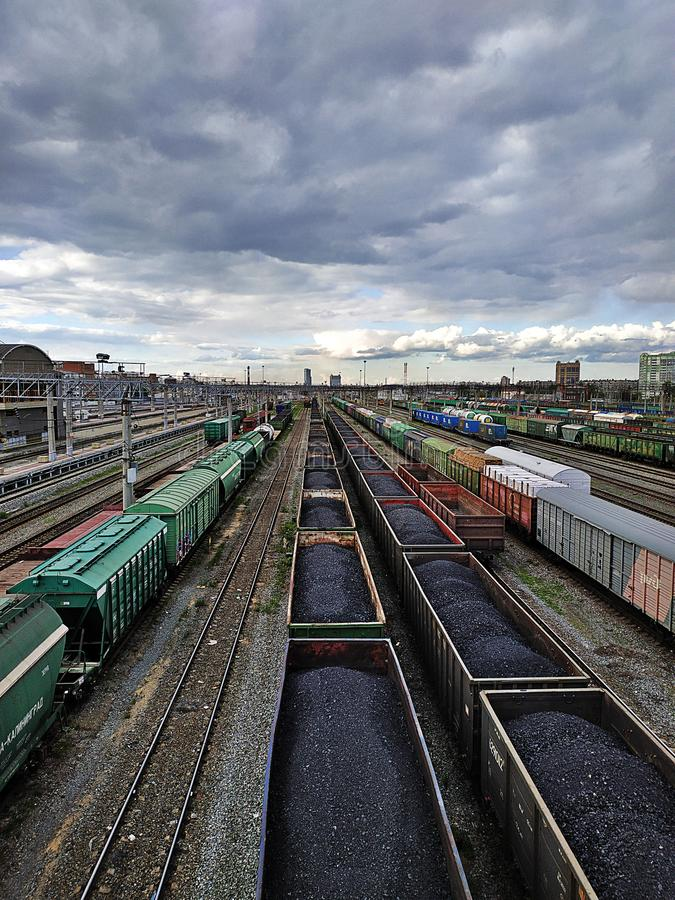Cargo wagons with coal. On train station in city, aerial view royalty free stock photos