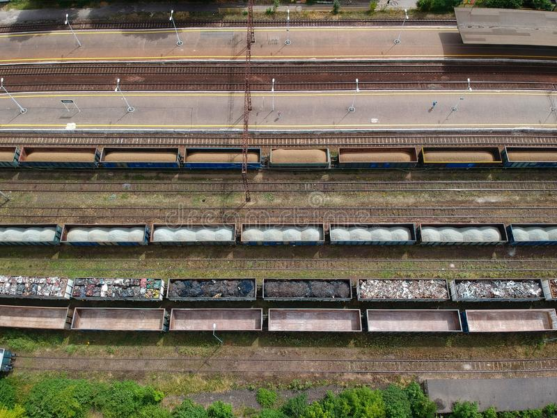 Cargo wagons on train station in city, aerial view.  stock photos