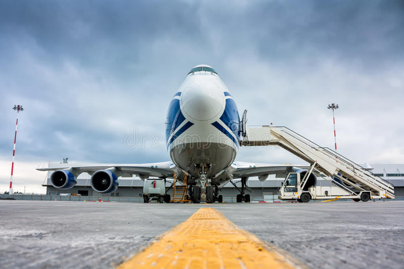 Cargo wide-body plane and aircraft passenger loader stock photography