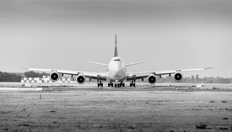Cargolux airline Boeing 747 airplane with 4 engines on ground monochrome. Cargolux airline Boeing 747 B747 airplane with 4 engines goes on taxiway to runway stock photos
