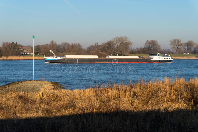 A cargoship at the river in the Netherlands royalty free stock photography