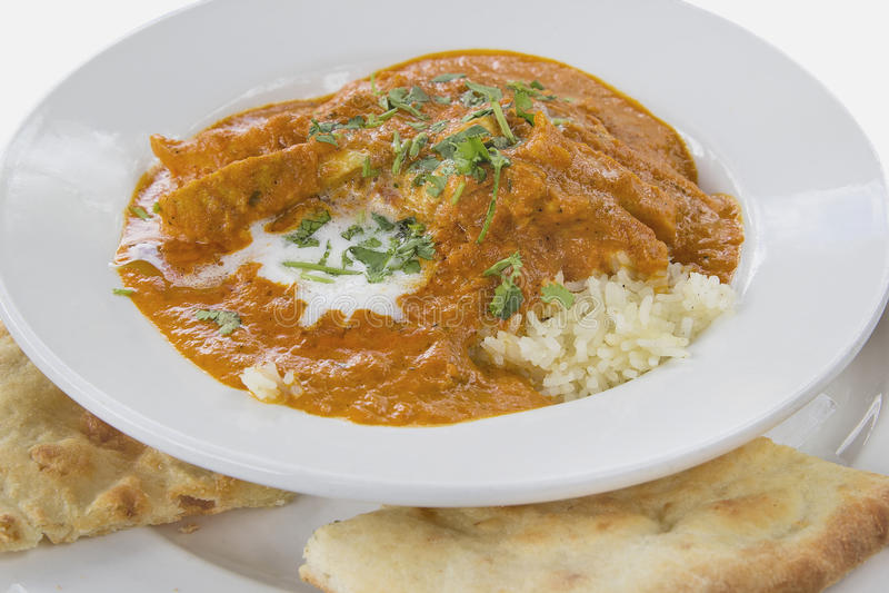 Cari de poulet de beurre d'Indien est avec Naan image stock