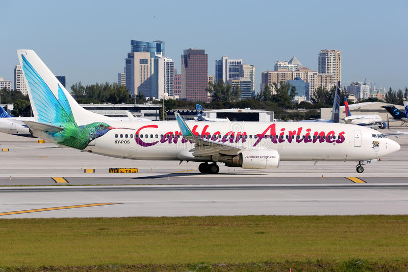 Caribbean Airlines Boeing 737-800 airplane Fort Lauderdale airport. Fort Lauderdale, United States - February 17, 2016: A Caribbean Airlines Boeing 737-800 with royalty free stock photo