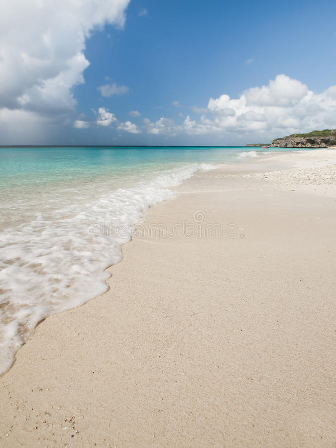 Caribbean beach. Beautiful tropical Caribbean beach with white sand, transparent water and deep blue sky royalty free stock photography