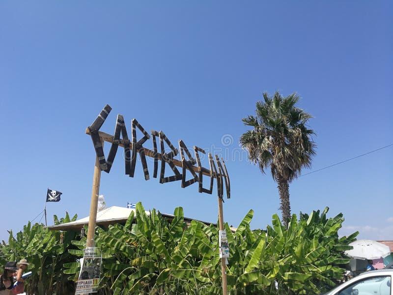 Caribbean beach bar. A Caribbean beach bar sign on the beach royalty free stock photos