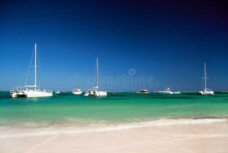 Caribbean beach with boat in ocean stock image