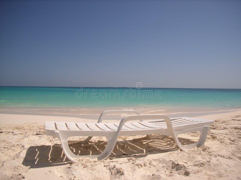 Caribbean beach chair stock images