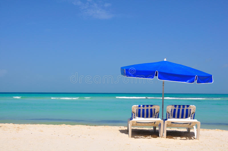 Caribbean Beach Chairs, Mexico. Caribbean beach with beach chairs and sunshade on the island Isla Mujeres, Mexico stock photo