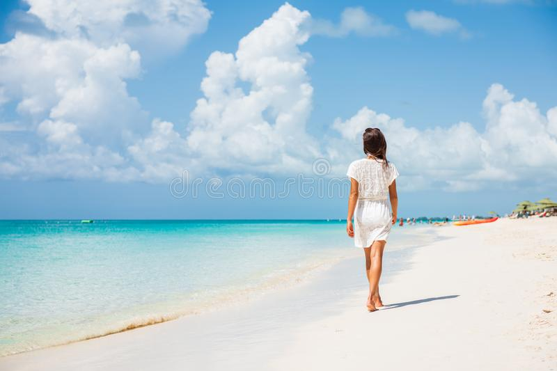 Caribbean beach luxury vacation summer holiday woman walking on perfect beach tourist destination. Caribbean beach luxury vacation summer holiday woman walking royalty free stock photo