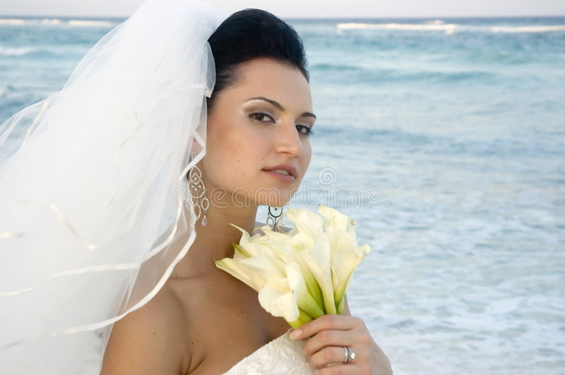 Caribbean Beach Wedding - Bride With Bouquet (soft focus) royalty free stock photo