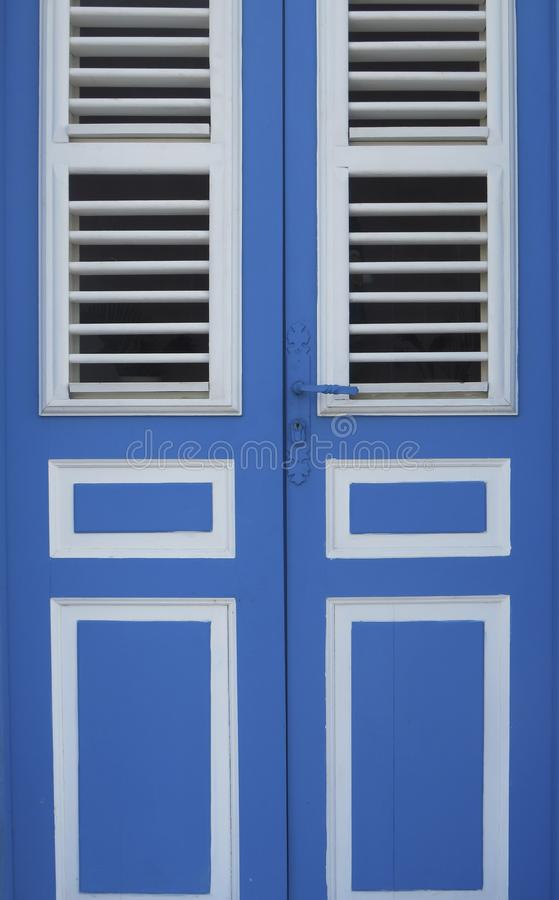 Caribbean blue and white entrance door close-up. Tropical architecture. Martinique, Antilles French West Indies stock image