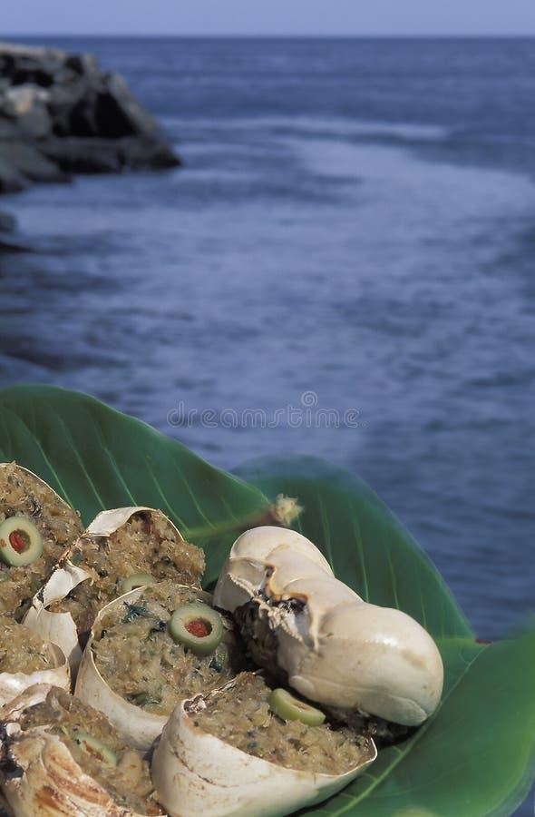 Caribbean food: crab-back stock photos