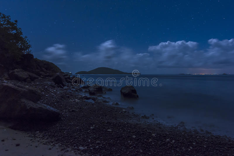 Caribbean island nights. Distant lights of Vieques island in the Caribbean under layer of clouds and starry night sky seen from northwestern peninsula of Isla royalty free stock image