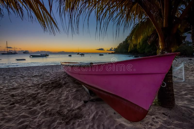 Caribbean Martinique beach sunset beside traditional fishing boat stock photos