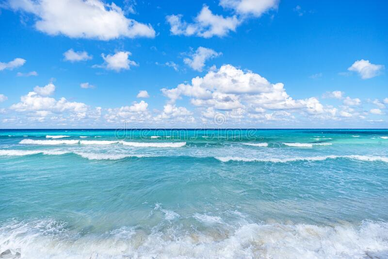 Caribbean sea surface summer wave background. Exotic water landscape with clouds. Natural tropical water paradise. Cuba nature. Caribbean sea surface summer stock images