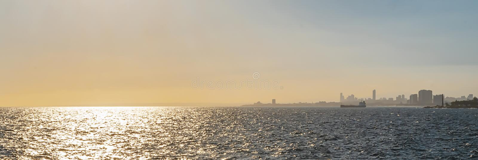 Caribbean sea view of Santo Domingo as golden tropical sunset royalty free stock photography