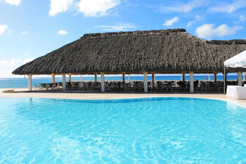 Caribbean Spa Hotel Pool and Ocean Landscape Background stock images