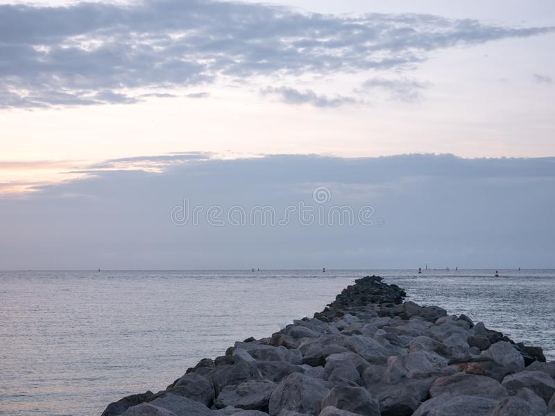 A Caribbean Sunrise with a Pier and some Rocks, Miami beach, Florida, USA.  stock images