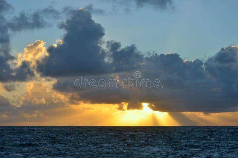 Caribbean sunrise. With sky and sea stock photos