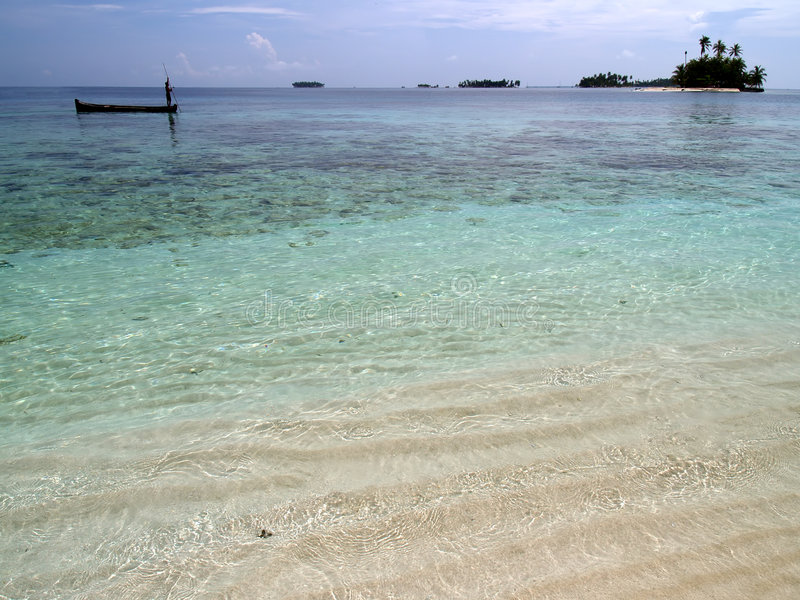 Caribbean tropical white sand beach. In panama with fisherman royalty free stock image