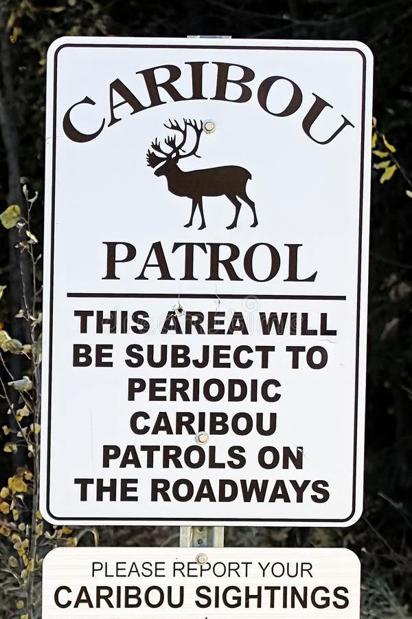 A caribou patrol sign indicating to report sightings.  stock photography