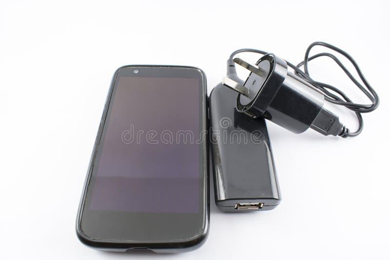 Caricatore del portatile e del cellulare immagine stock libera da diritti