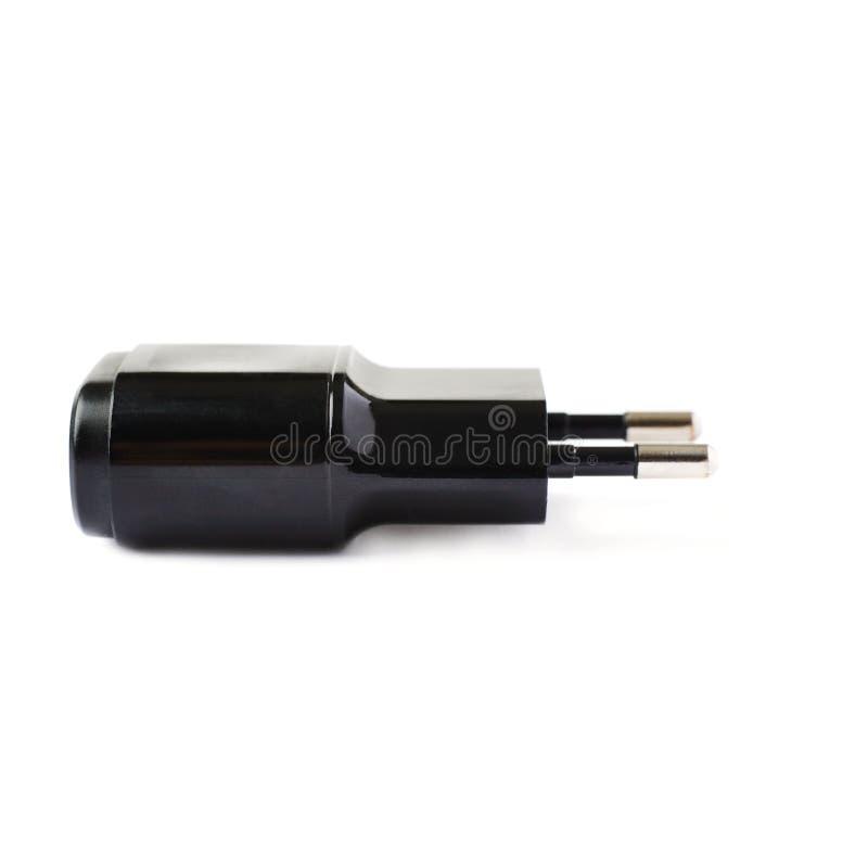 Caricatore dell'adattatore USB isolato sopra i precedenti bianchi immagini stock libere da diritti