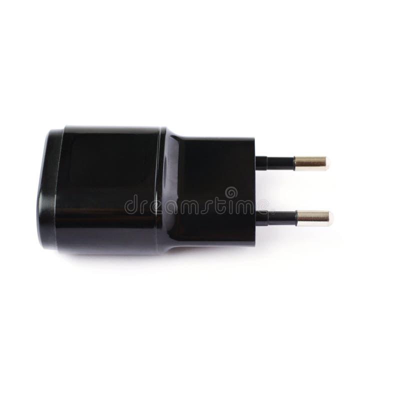 Caricatore dell'adattatore USB isolato sopra i precedenti bianchi immagini stock
