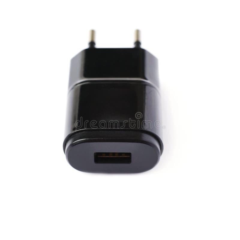 Caricatore dell'adattatore USB isolato sopra i precedenti bianchi fotografia stock libera da diritti