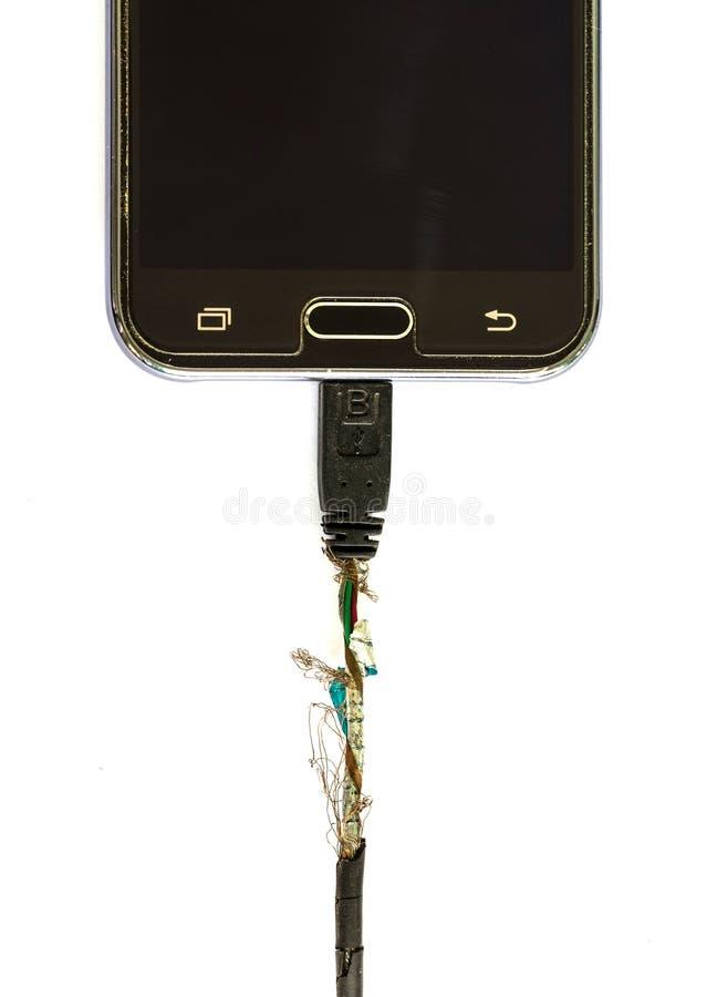 Carico nocivo del telefono cellulare sul fondo bianco immagine stock libera da diritti