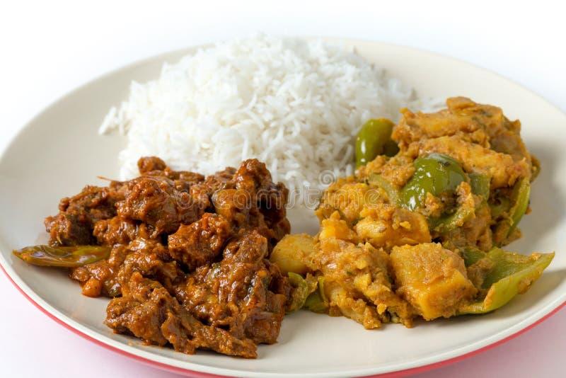 Caril da carne com batata e arroz foto de stock royalty free