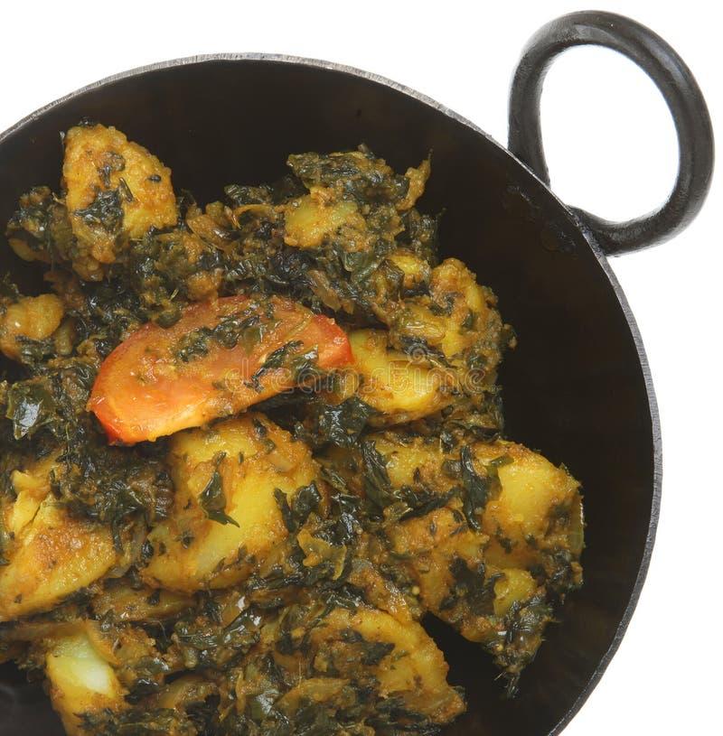 Caril indiano do espinafre & da batata (caída Aloo) imagem de stock royalty free