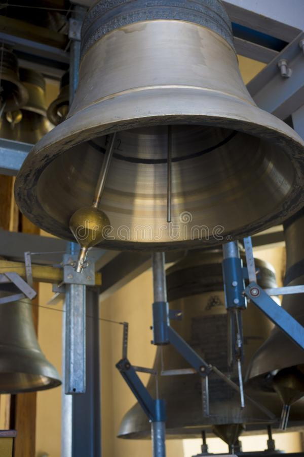 Carillon - bell with automatic mechanical vibration device. A carillon consists of at least 23 cast bronze, cup-shaped bells. This is the heaviest musical royalty free stock photos