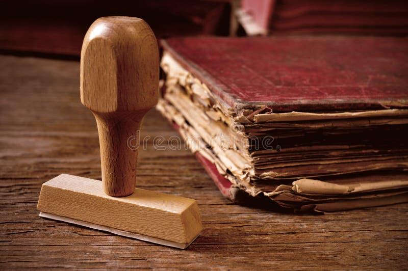 Carimbo de borracha e livro velho foto de stock royalty free